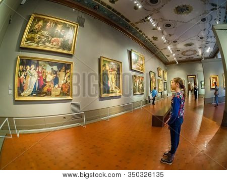 Moscow, Russia - Jan 14, 2020: Schoolgirl Examines An Exhibition Of Painting Of Pushkin State Museum