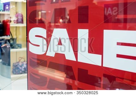 Sales Promotion Of Fashion Retail Store In Shopping Mall. Store Front Display For Fashion Background