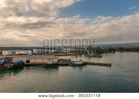 Hilo, Hawaii, Usa. - January 9, 2012: Sunset Over Harbor With White Brown Cloudscape With Blue Patch