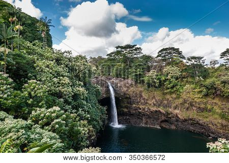 Hilo, Hawaii, Usa. - January 9, 2012: Blue Sky With Big White Clouds Above Rainbow Falls, Today With