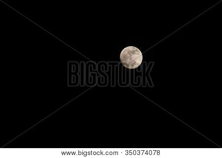 Full Moon At Night With A Black Background