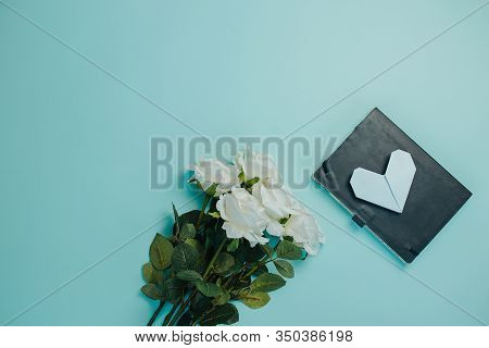 Spring Freshness Card. White Roses With Green Leaves On Blue Background. Bunch Of White Roses With L