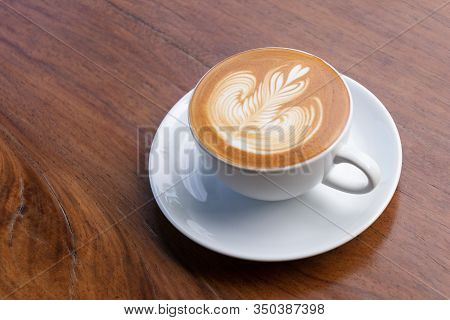 Coffee Cup With Latte Art Foam On Wood Table In Coffee Shop With Copy Space.coffee Is One Of The Mos