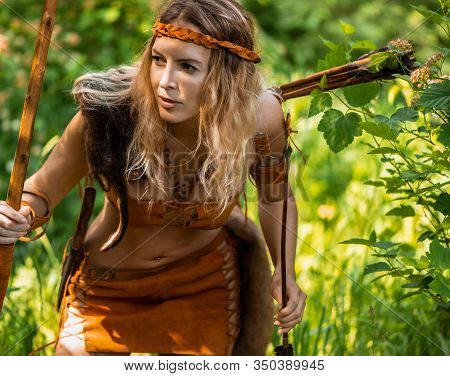 Beautiful Girl Archer With Long Blond Hair With A Bow And Arrows Dressed In Leather
