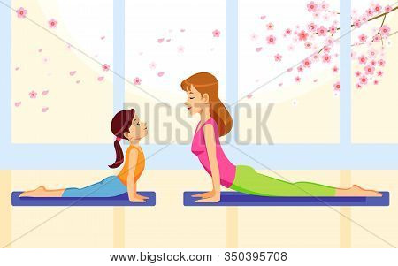 Happy Smiling Mother And Daughter Together Doing Yoga Exercises At Home. Concept Motherhood Child-re