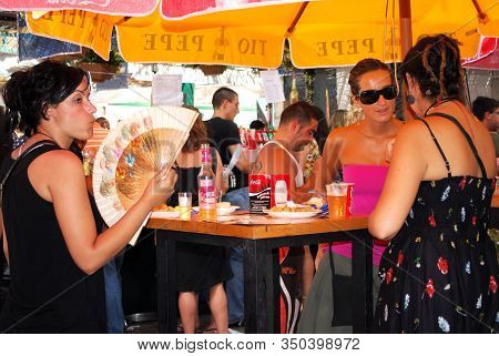 Malaga, Spain - August 18, 2008 - Spanish Women Relaxing At A Pavement Cafe At The Feria De Malaga,