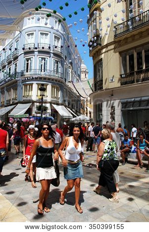 Malaga, Spain - August 18, 2008 - Young Women Walking Along Calle Marques De Larios During The Feria