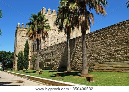Jerez De La Frontera, Spain - August 20, 2008 - View Of The Castle Wall And Turret With Palm Trees I