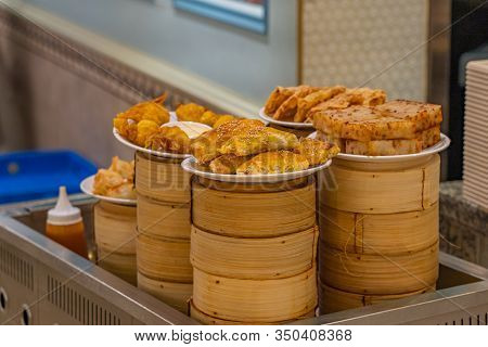 Delicious Fried Dumpling And Wonton On Dimsum Bamboo Steamer Boxes