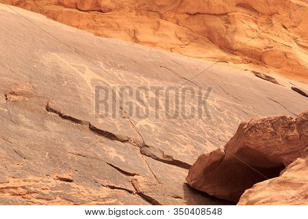 Thamudic And Nabataean Petroglyphs And Inscriptions On Mountain In Wadi Rum Desert, Jordan