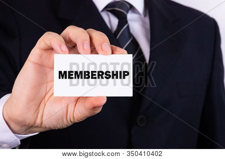 Businessman Holding A Card With Text Membership