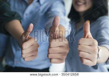 Closeup Gruop Of Business People Giving Thumbs Up. Group Of People Show Confirm With Thumb Up.