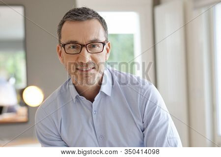 Portrait of middle-aged man with eyeglasses