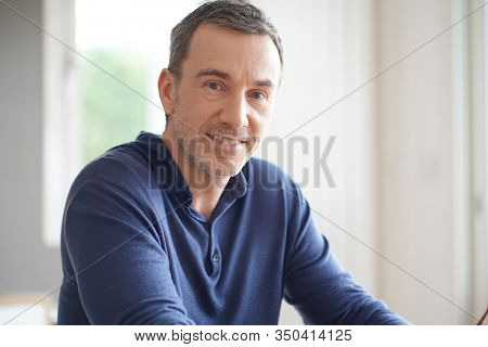 Portrait of middle-aged man with blue shirt