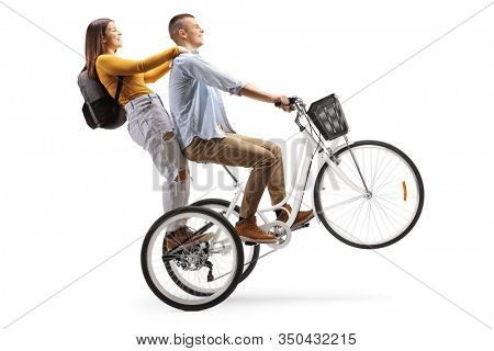 Young man riding a female student on a tricycle isolated on white background