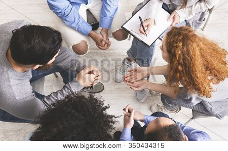 Discussion Group Concept. Diverse People Discussing Their Problems With Others Seated In Circle, Top
