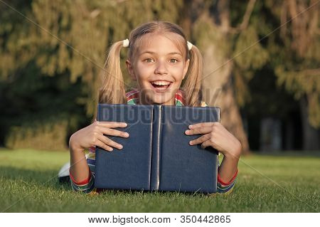 Great Place To Read. Happy Small Child Read Library Book Outdoor. Adorable Little Girl Learning To R