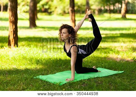 Yoga Practice In Park, Meditation Outdoors In Summer.
