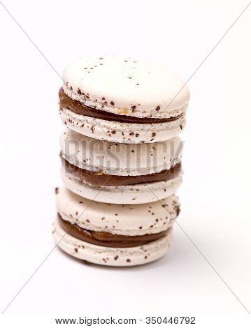Stack Of French Caramel Macarons Three White Macarons On White Background Vertical Close Up