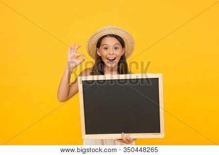 Publicity And Education. Happy Child Give Ok Sign. Little Kid Hold Blank Blackboard. School Publicit