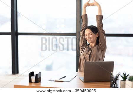 Good Morning. Happy Female Manager Stretching Her Body And Arms Working At Home Or Modern Office, Co