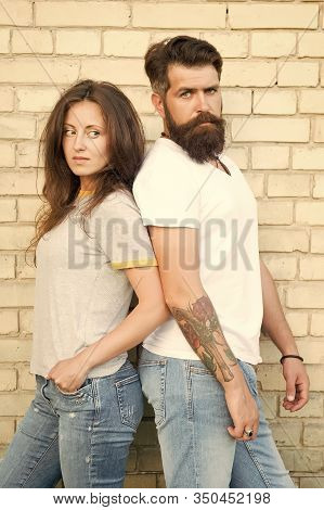 Couple In Love Romantic Date Huddle Outdoors Brick Wall Background. Urban Youth On Date. Casual Meet