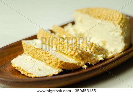 Smoked Cottage Cheese, Brined Cheese Cut On A Plate