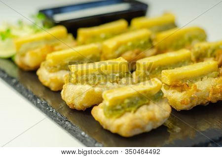 Skinless And Boneless Battered Alaska Pollock Fillet Pieces, Topped With Mushy Peas And Fried Potato