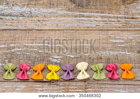 Organic Colored Pasta On A Wooden Background. Pasta Colored With Natural Dyes.