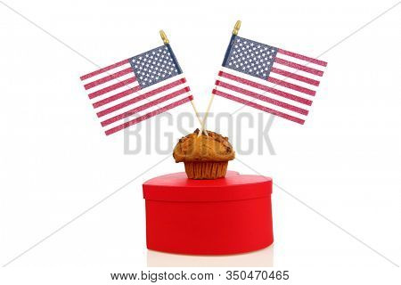 Muffin with American Flags. Isolated on white. Room for text. Muffins are enjoyed every day by people in the United States of America. Have a Muffin Today. God Bless America.