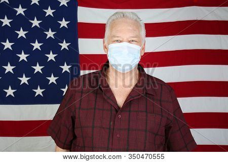 2019 Novel Coronavirus. 2019-nCoV. Wuhan, China 2019 Novel Coronavirus. A Caucasian Man wearing a paper mask is scared of contracting the CORONAVIRUS. Room for text. Protect yourself today.