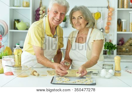 Senior Couple Baking In The Kitchen At Home