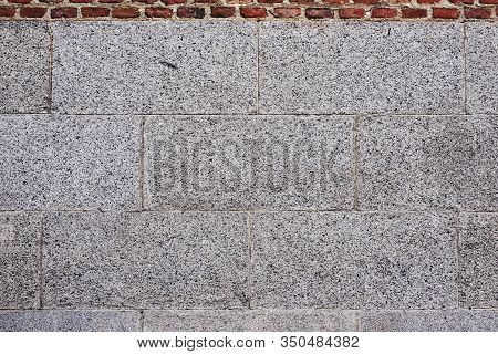 An Antique Stone Slabs Wall Texture Background.