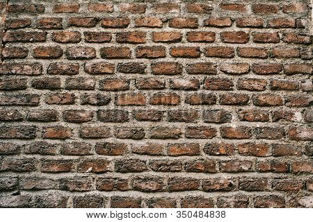 An Antique Red Brick Wall Texture Background