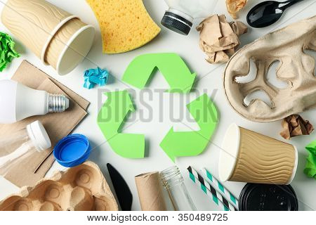 Recycle Sign On White Background With Different Trash, Top View