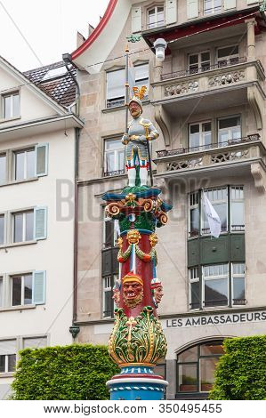 Lucerne, Switzerland - May 7, 2017: The Fritschi Fountain With Standard-bearer Statue Was Erected In