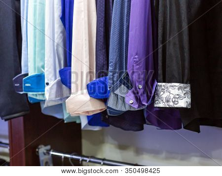 Wardrobe With Men's Shirts In Different Colors