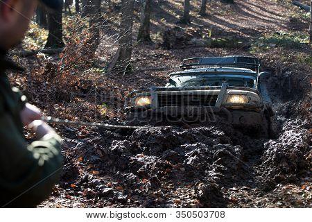 Off Road Car. Scene Mud Splash In Off-road Racing. Wheel In Deep Rut Goes Through Mud And Leaves Tra