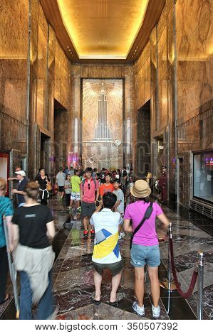 New York, Usa - July 4, 2013: People Visit Empire State Building Lobby In New York. The Art-deco Sty