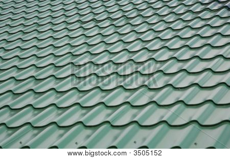 View of the roof covered by green tile poster