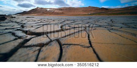 Dried land in the desert. Cracked soil crust