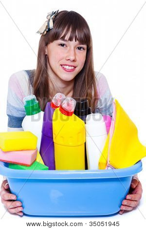 Beautiful smiling teenage girl with cleaning agents
