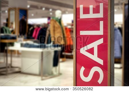 Shopping Sale Background. Signage Sale In A Clothing Store.