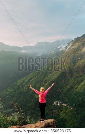 Woman Meets Sunrise In The Mountains. Girl Traveling To Sri Lanka. Mountain Sports. Athlete Happy Fi