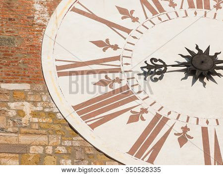 Ancient Times And Hours. Old Clock With Roman Numbers From Lucca Clocktower (18th Century)