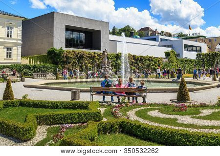 Salzburg, Austria - May 17, 2019: This Is The Big Fountain In Mirabell Park And The Modern Building