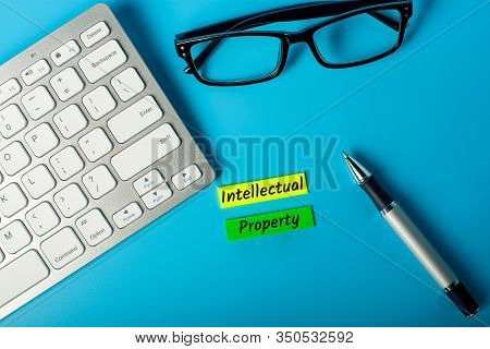 Intellectual Property - Tags On Workplace. Theme Of Protection Of Intellectual Property, Inventions,
