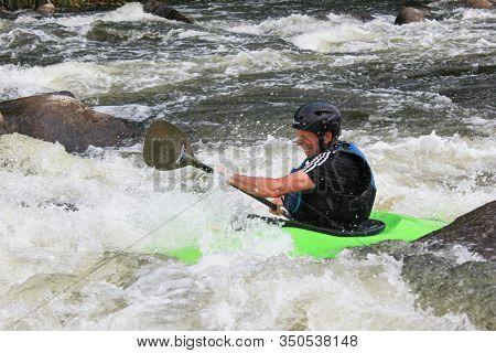 Livingstone - October  22 2019:  Adult Man Ride A Kayak On The Zambezi River Rapids In Livingstone,