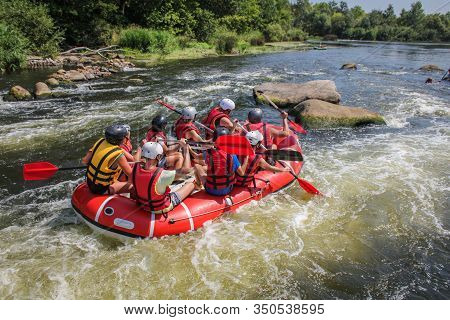 Group Of Adventurer Enjoying Water Rafting Activity. Rafting On The Maetang River Of Thailand. The R