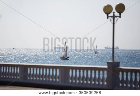 Promenade With Balustrade On The Background Of The Sea, Yacht On A Clear Sunny Day. The Resort Of Ge